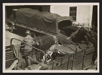 thumbnail image for George Stout and two unidentified men loading a truck at Altaussee, Austria