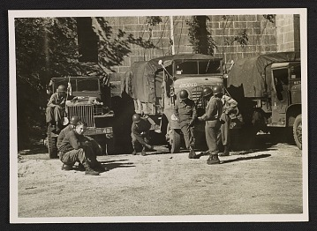 thumbnail image for Soldiers standing in front of trucks for transporting art recovered in the salt mines at Altaussee, Austria