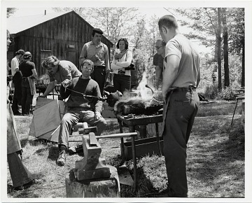 thumbnail image for Attendees at a blacksmithing workshop