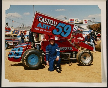 thumbnail image for Bobby Essick kneeling in front of Castelli Art car no. 59