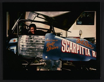 thumbnail image for Salvatore Scarpitta in his dirt track race car, no. 59