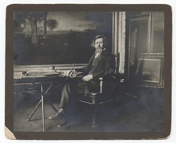 thumbnail image for George Inness seated in his studio
