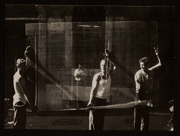 thumbnail image for Men moving a pane of glass
