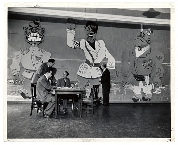 thumbnail image for Art Students League faculty seated around a table in front of a mural
