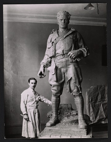 thumbnail image for Pietro Montana with his doughboy sculpture