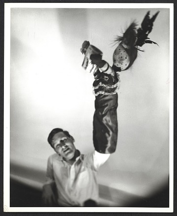 thumbnail image for John Bernard Myers with a puppet on his hand