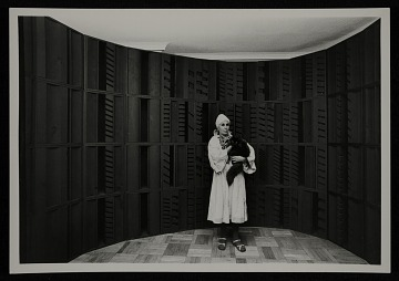 thumbnail image for Louise Nevelson with cat in front of wall sculpture