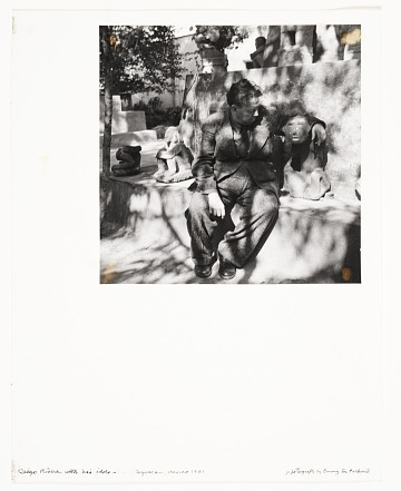 thumbnail image for Diego Rivera sitting among sculptures of idols