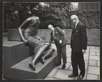 thumbnail image for Andrew Ritchie and Henry Moore with Moore's sculpture <em>Draped seated woman</em> at Yale
