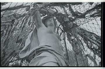 thumbnail image for Sculpture covered in camouflage netting