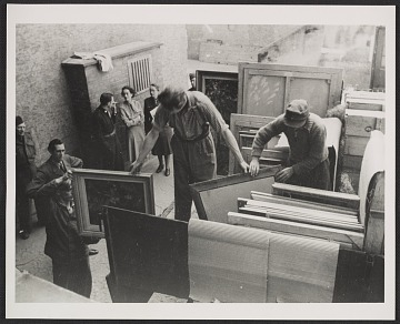 thumbnail image for Edith Standen, Rose Valland and a soldier converse while men prepare paintings for transportation