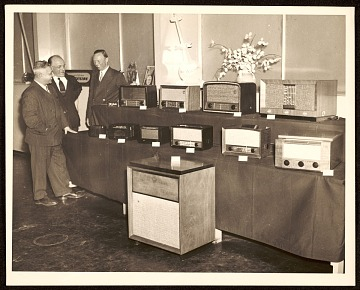 thumbnail image for John Vassos and RCA colleagues with a display of RCA products
