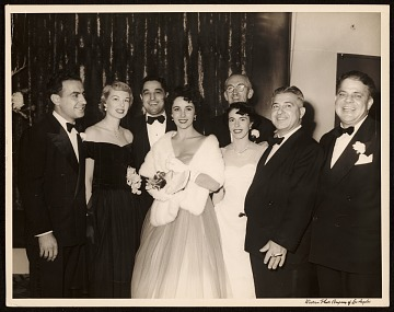 thumbnail image for John Vassos (second from right), Elizabeth Taylor (center), and others at re-opening of the Egyptian Theatre in Los Angeles