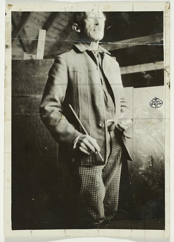 thumbnail image for Abbott Handerson Thayer holding a palette and brush in his Dublin, New Hampshire studio
