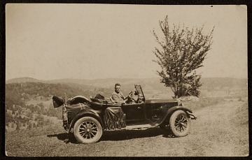 thumbnail image for Robert Strong Woodward in a car