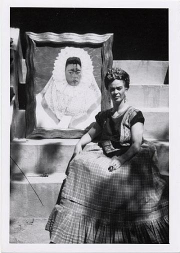 thumbnail image for Frida Kahlo with her painting, <em>Self-Portrait as a Tehuana</em>