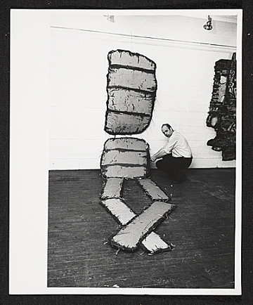 thumbnail image for Claes Oldenburg and one of his works in his show <em>The Street</em> at the Reuben Gallery