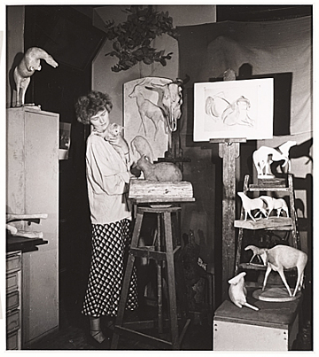 thumbnail image for Rhys Caparn with cat in her studio