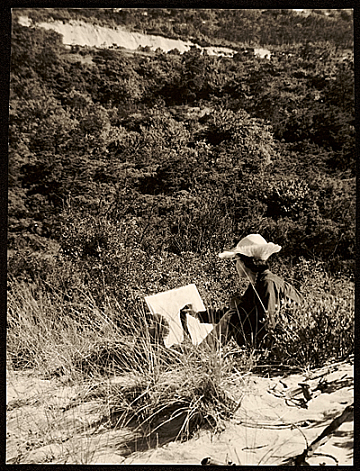 thumbnail image for Female student sketching in the dunes