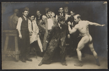 thumbnail image for Art students posing with an artists' model