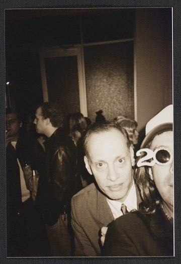 thumbnail image for John Waters and Colin de Land at a party