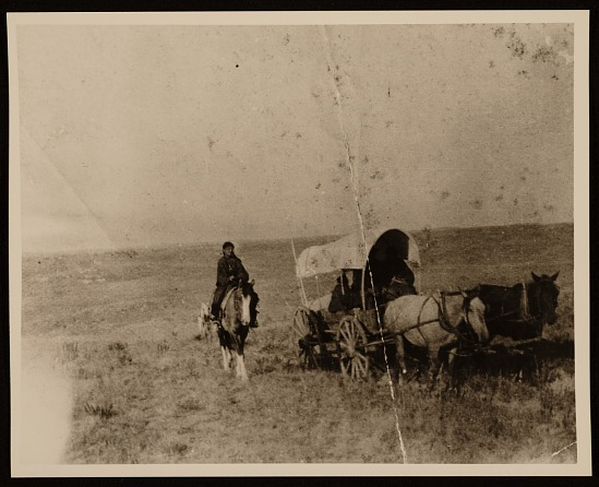 image for Native Americans traveling in covered wagon