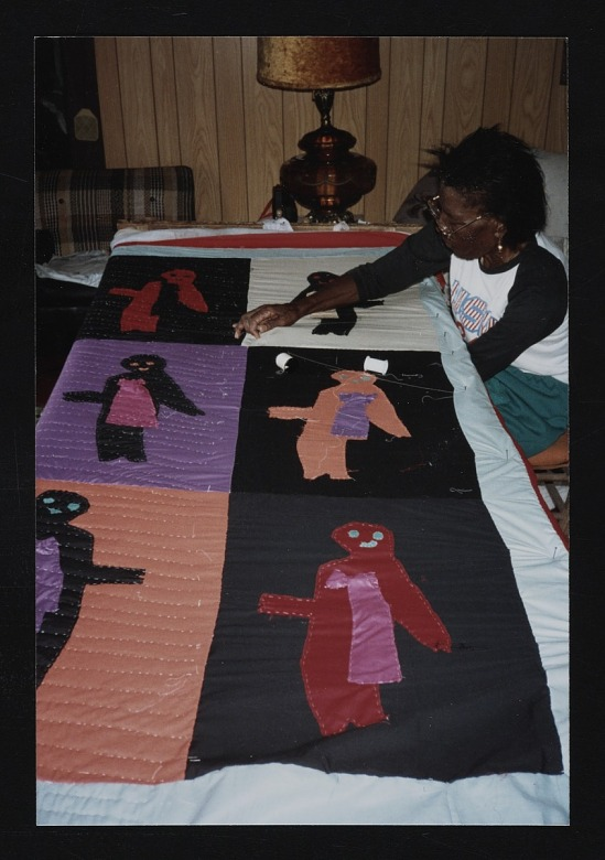image for Sarah Mary Taylor working on quilt