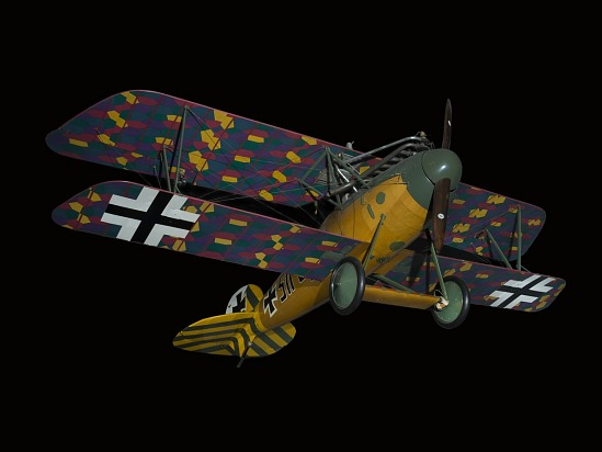 Biplane with multi-color, camouflaged wings, wood grain finish fuselage, and green and yellow                 details on tail and nose, seen from below
