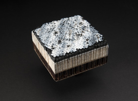Square sample of Gemini heat shield material with white honeycomb surface on top