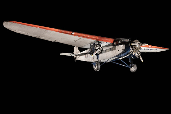 Silver, red, and blue Ford 5-AT Tri-Motor aircraft