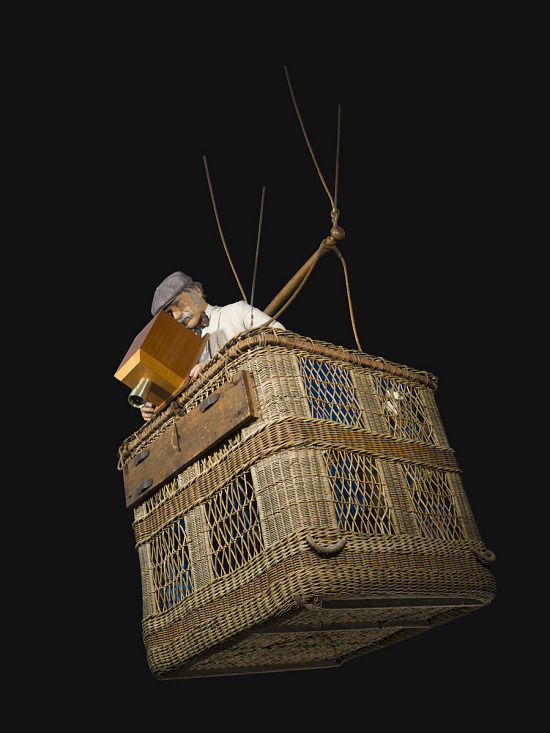 Rope basket with man mannequin inside using wooden box shaped camera
