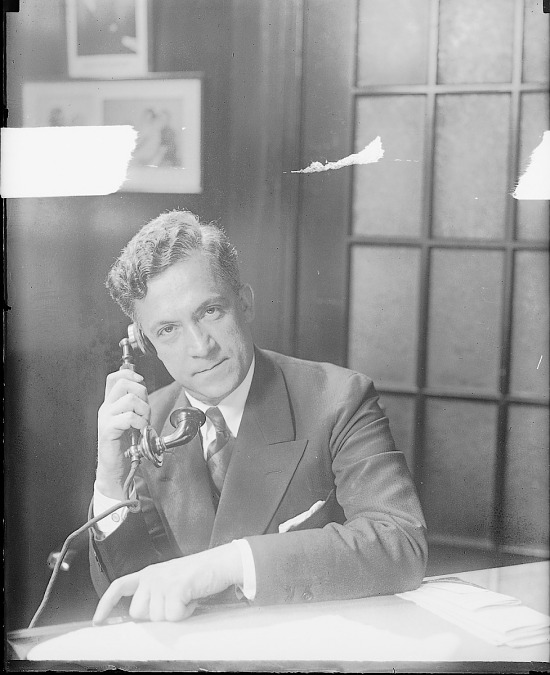 image for Man in suit talking on telephone. Active no. 2037 : photonegative.