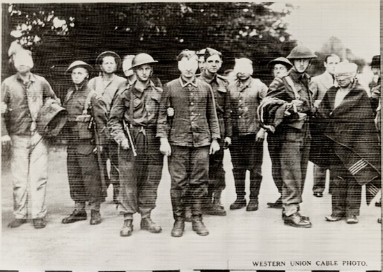 image for Western Union Cable Photo; WWII soldiers with blindfolded prisoners. b&w photoprint