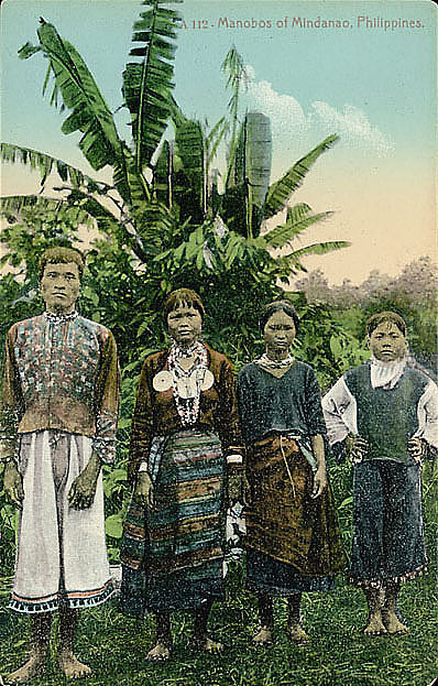 image for Man and Three Women in Costume Near Banana Trees n.d