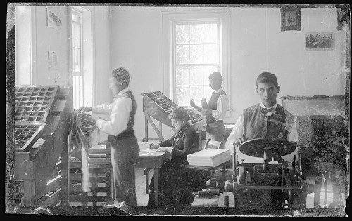 image for Three Young American Indian Men and White Woman Working in School Print Shop 1879