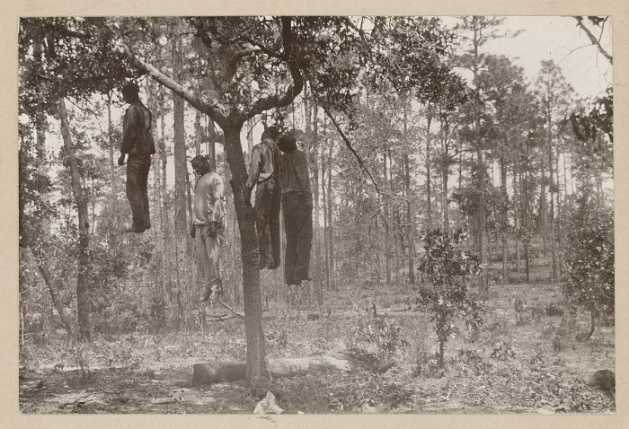 Photograph of the lynched bodies of four men | National Museum of African  American History and Culture