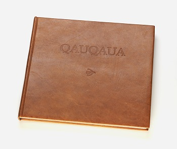 Photo of Artist book: Qauqaua : a San folk story from Botswana told by Coex'ae Qgam published by Artists' Press, 1996. Quagua Cover. African Art Museum artists' books exhibit research image.