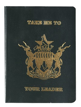 Photo of Artist book: Take me to your leader by Daniel Halter, 2006. Cover. African Art Museum artists' books exhibit research image.