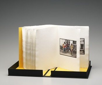 Photo of Artist book: Colored people by Blake J. Nolan, 2008. Cover Open Book. African Art Museum artists' books exhibit research image.