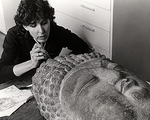 Jane Norman repairing artifact