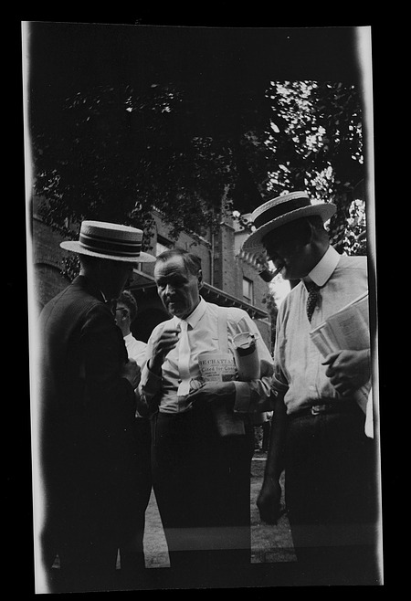 Clarence S. Darrow (center) standing near Rhea County Courthouse with unidentified man (left) and Go