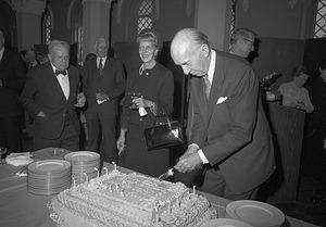 Secretary Ripley Cutting Anniversary Cake