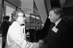 Abram Lerner Greeting First Visitor to HMSG