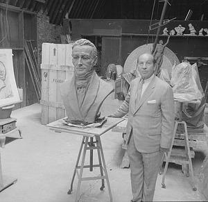 Scupltor Felix de Weldon and Bust of James Smithson