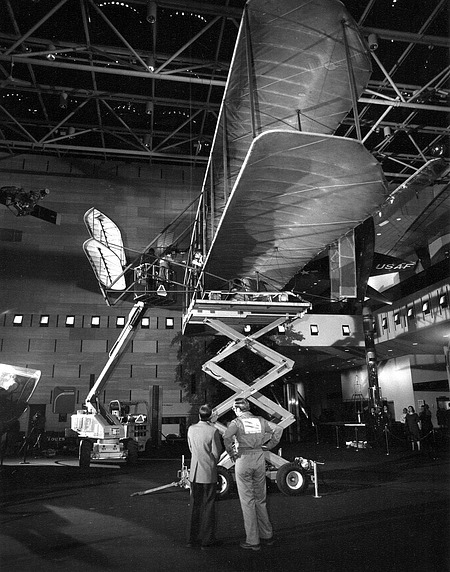 Taking Down the Wright Flyer, by Avino, Mark, 1985, Smithsonian Archives - History Div, 85-1133-3.