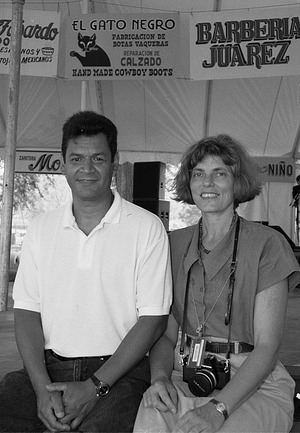 Rolando Mayen and Paula Kaufman Pose under Signs Created for Borderlands' Program