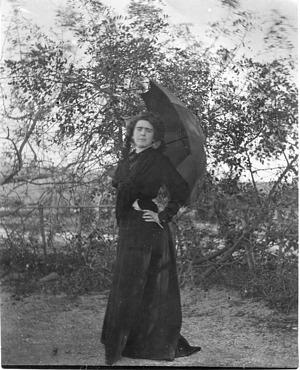 Laura Barney Poses with Umbrella