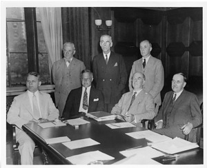 (left to right): Isaiah Bowman (1878-1950), Robert Andrews Millikan (1868-1953), Karl Taylor Compton (1887-1954), Charles Kenneth Leith (1875-1956), William Wallace Campbell (1862-1938), Frank B. Jewett (1879-1949), John Campbell Merriam (1869-1945)