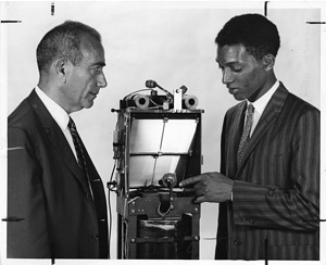 (left to right): Herbert Friedman (1916-2000) and George Robert Carruthers (b. 1939)
