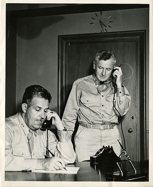 Major General Leslie R. Groves (seated) with his assistant Brigadier General Thomas F. Farrell